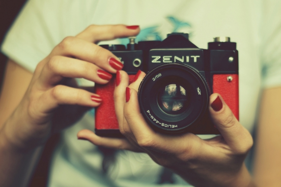 woman holding retro camera