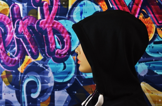 mannequin wearing black clothes ear artistic wall