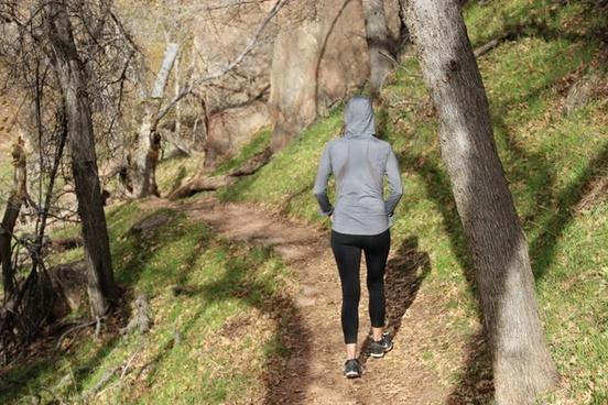 woman in hoodie 038 yoga pants walking through nature