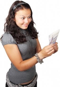 woman looking at money