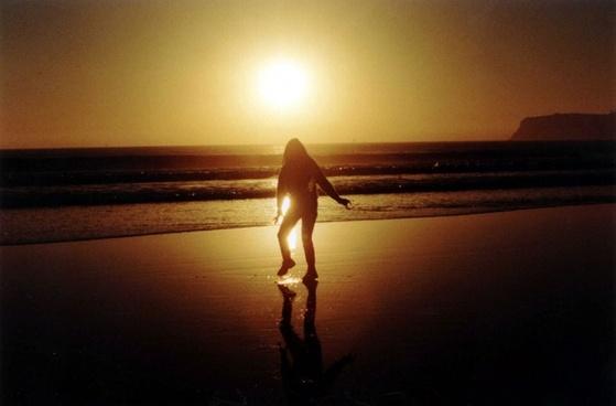 woman on coronado beach at sunset