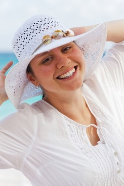 woman with a hat on beach