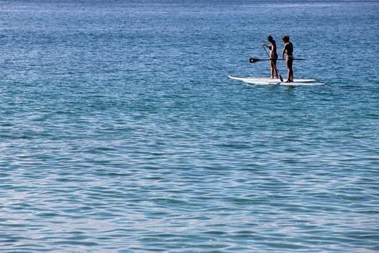 women on paddle boards in ocean