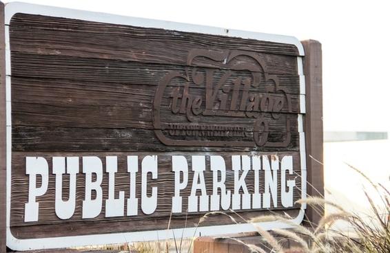 wood public parking sign