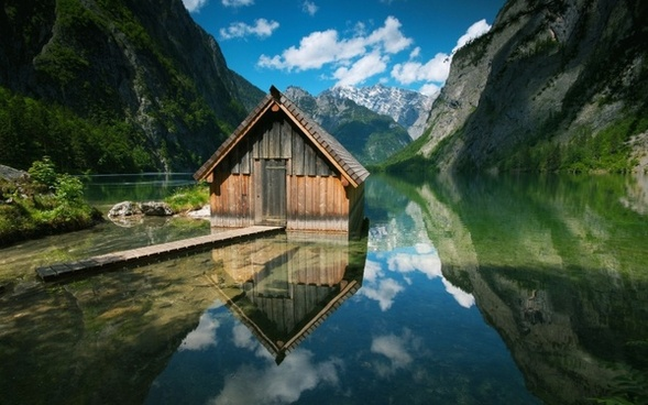 wooden houses lakes mountains