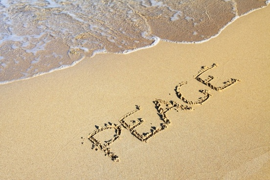 word peace in sand