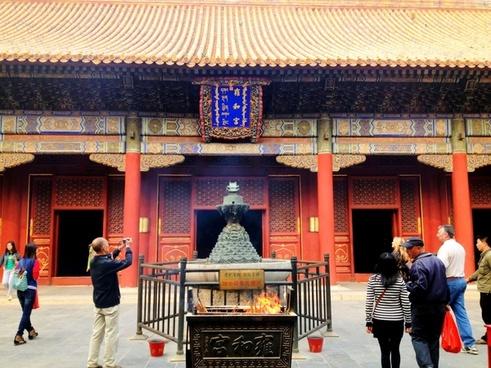 worshipping at lama temple in beijing china