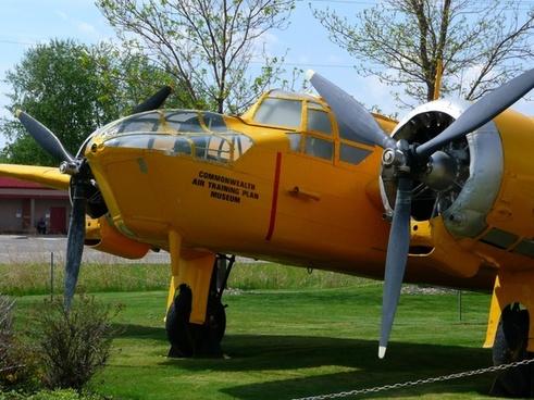 yellow two engine propeller plane