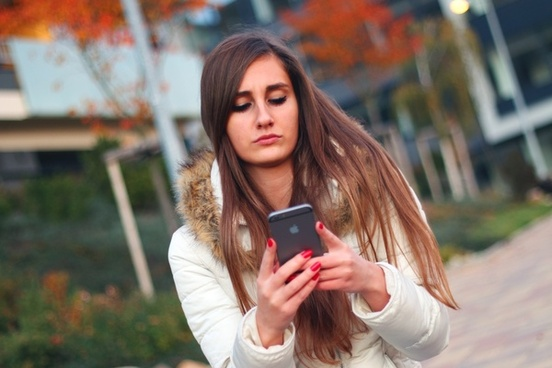 young girl with iphone 6