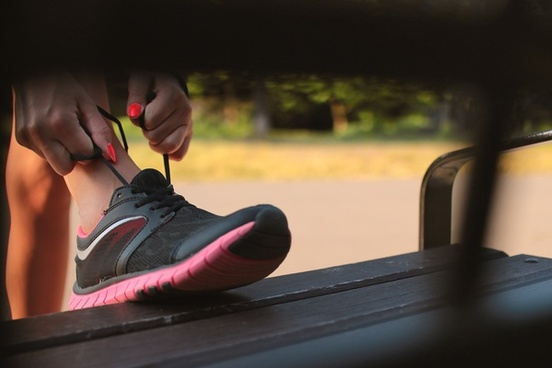 young runner tying her shoelaces