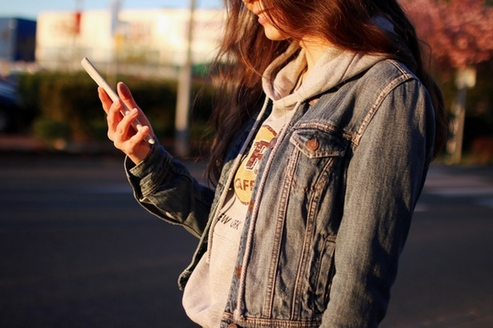 young woman using a smartphone on a city street