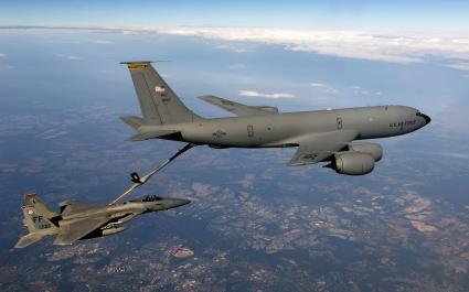 F 15 Eagle Receives fuel from KC 135 Stratotanker