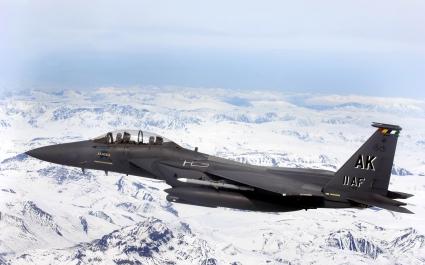 F 15E Strike Eagle flys over Glacial fields