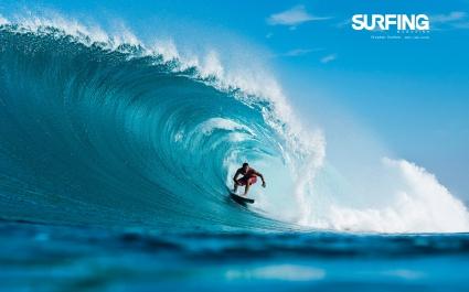 Surfing in Teahupoo Tahiti