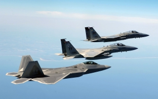 An FA 22 Raptor Two F 15 Eagles