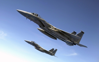 F 15 Eagles Fly Over the Pacific Ocean