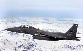 F 15E Strike Eagle flys over Glacial fields
