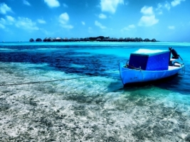 Old boat at Kuda Huraa Wallpaper Maldives World
