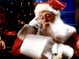 Santa Claus reading Wallpaper Christmas Holidays